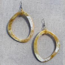 Large, fine earrings of horn
